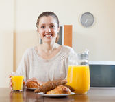 Woman having breakfast with juice  — Stockfoto