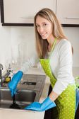 Woman cleaning pipe with plunger   — Stock Photo