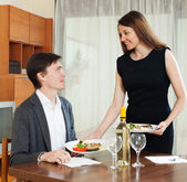 Loving girl serving dinner — Stock Photo