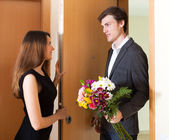 Young woman and man greeting — Stock Photo