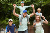 Parents with kids outdoor — Stock Photo