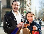 Positive couple at european street — Stock Photo