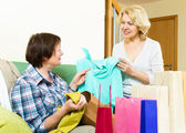 Women talking on their purchases — Stock Photo