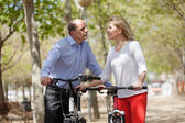 Mature couple with bicycles — Stock Photo