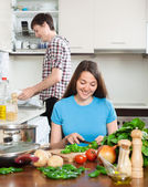 Happy girl with man cooking — Stock Photo
