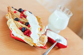 pancakes with berries and glass of milk — Stock Photo
