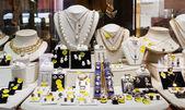 luxury golden jewelry in store window — Stock Photo
