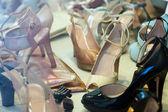 Showcase with female shoes — Stock Photo