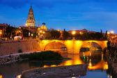 Old bridge over Segura river in evening. — Photo