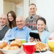 Happy family of three generations with electronic devices — Stock Photo #50778469