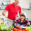 Elderly couple cooking with tomatoes — Stock Photo #50778661