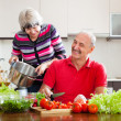 Mature couple cooking with tomatoes — Stock Photo #50778663