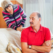 Mature couple after quarrel in living room — Stock Photo #50778701