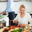 Happy mature couple cooking healthy food — Stock Photo
