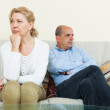 Mature couple after quarrel at home — Stock Photo