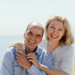 Woman with man together against sea — Stock Photo #50779027