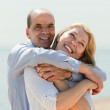 Mature man and woman together against sea — Stock Photo #50779047