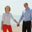 Woman with elderly man together against sea — Stock Photo #50779049