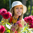 Female florist working in garden — Stock Photo #50779155