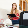 Girl laying on sofa near luggage — Stock Photo
