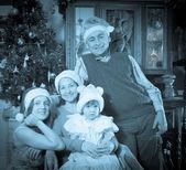 Imitation of antique photo of happy  family — Stock Photo