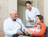 Pediatrician doctor examining little baby — Stock Photo