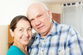 Smiling mature couple  in home — Stock Photo