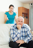 Upset man against angry woman — Stockfoto