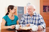 Happy mature couple having tea — Stock Photo