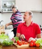 Happy elderly couple doing chores   — Stok fotoğraf