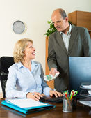 Female secretary receiving from boss salary — Stock Photo