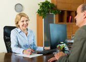 Senior man with bank manager — Stock Photo