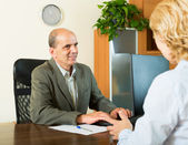 Pensioner at notary's office — Stock Photo