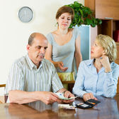 Daughter asking parents for money — Stock Photo