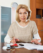 Sad mature woman thinking — Stock Photo