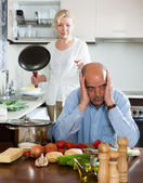 Mature couple having quarrel at kitchen — Stock Photo