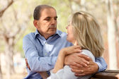 Happy senior lovers hugging each other — Stock Photo