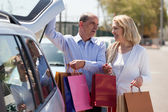 Mature couple near car — Stock Photo