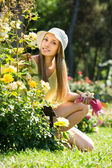 Female gardene near bush  — Stock Photo