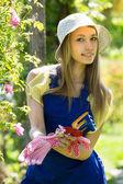 Female florist in the garden — Stock Photo
