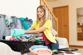 Girl packing luggage — Stock Photo