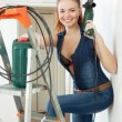 Young woman in overalls with drill — Stock Photo #50921695