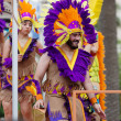 Постер, плакат: Guys in colored feathers at Gay pride parade
