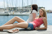 Two  young girls on the berth — Stock Photo