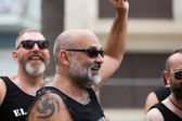 Happy bearded men at  gay pride parade in Sitges — Stock Photo