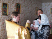 Performing christening ceremony — Stock Photo
