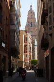 Narrow street with Cathedral Bell tower — Stock Photo