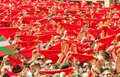 Cheering people with red shawl — Stock Photo