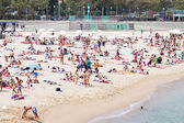 Holidaymakers sunbathing at Nova Icaria beach in Barcelona — Stock Photo