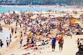 People sunbathing on  Mediterranean beach — Stock Photo